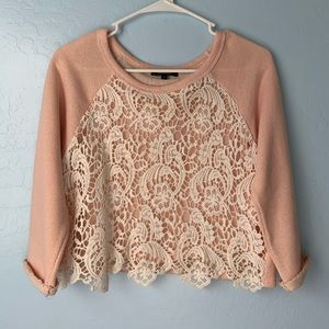 Pink sweater wuth crochet detailing